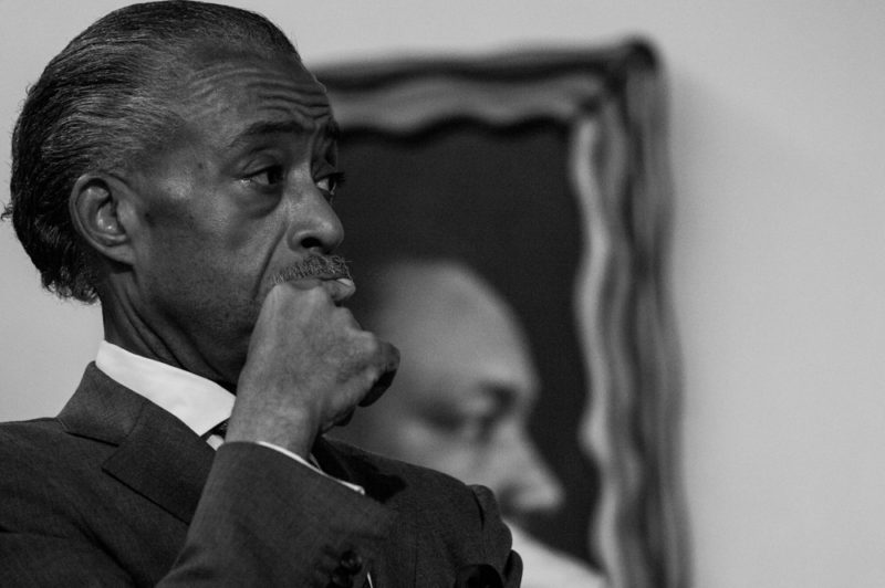 Javier Payne and his family joined Rev. Al Sharpton at the national Action Headquarters in Harlem on May 24, 2014 to call for swift justice in the recent incident involving the NYPD. (Robert Stolarik for JJIE)