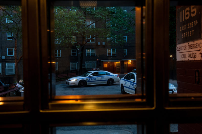 Police cars parked outside PSA 8 at the Edenwald Houses in the confines of the 47th Precinct in the North Bronx on May 17, 2014. (Robert Stolarik for JJIE.)