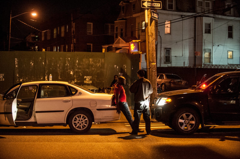 Members of the NYPD stopped vehicles along White Plains Road on May 17, 2014 in the North Bronx, where there has been a recent surge in gun violence.(Robert Stolarik for JJIE)