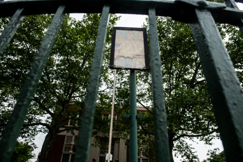 A weathered sign outside Public School 22 on May 21, 2014 in the Bronx where Javier Payne attends the 8th grade. (Robert Stolarik for JJIE)