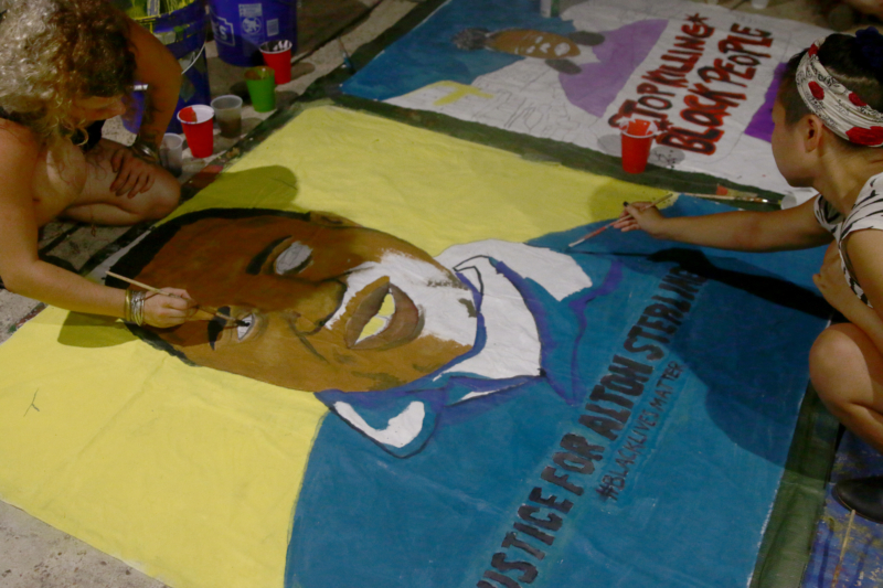 Police Violence: NEW ORLEANS, LOUISIANA. July 8, 2016. Young activists at the Radical Arts and Healing Collective in New Orleans prepare a banner portraying Alton Sterling, an African American Baton Rouge resident killed by police officers on July 5, 2016.