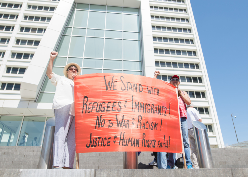 Colotl's Immigration Fight: Jessica Colotl Rally: Two protesters gave the power sign as they held up their placard at the rally.