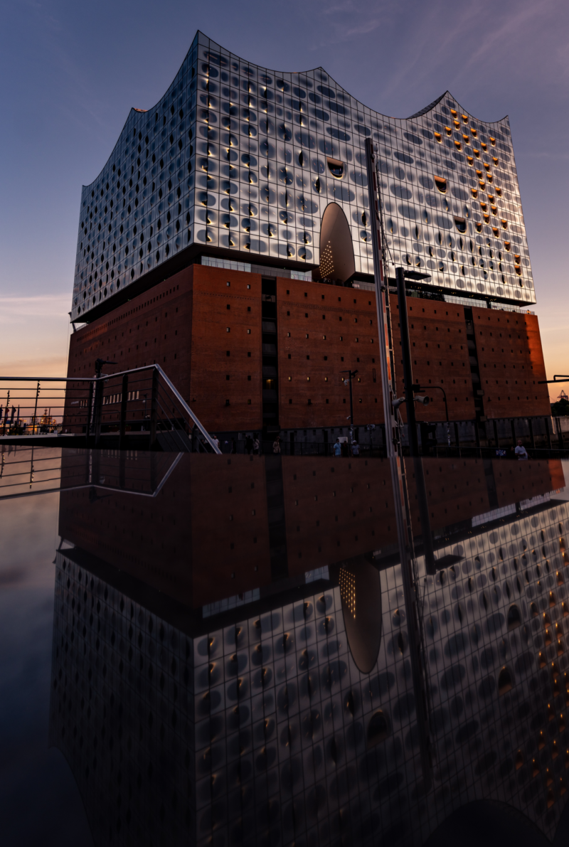 TheElbphilharmonie opera house against an early dusk sunset sky.