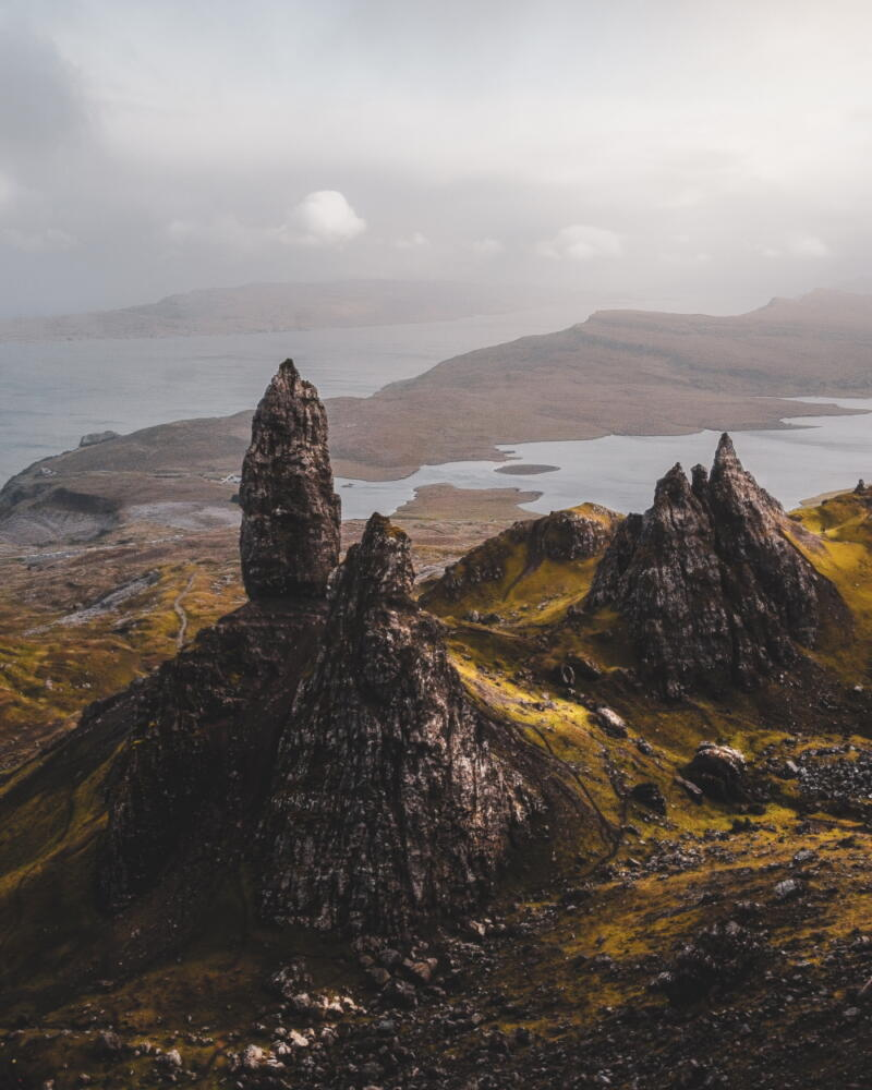 Chris Onooha: Old Drone of Storr-An ariel view of bays and low hills on a foggy day