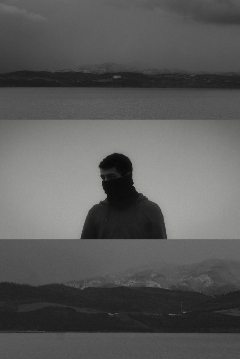 Syed Hamza: Sihouette of man faving camera against gray sky